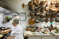 Chef Angela Ceriello cooking in the kitchen of the restaurant E Curti in Santa Anastasia, Italy