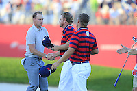 Ryan Moore and J.B. Holmes US Team beat Danny Willett and Lee Westwood (ENG) Team Europe on the 18th green during Saturday Afternoon Fourball Matches of the 41st Ryder Cup, held at Hazeltine National Golf Club, Chaska, Minnesota, USA. 1st October 2016.<br /> Picture: Eoin Clarke | Golffile<br /> <br /> <br /> All photos usage must carry mandatory copyright credit (&copy; Golffile | Eoin Clarke)