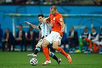 Ron Vlaar of the Netherlands takes on Lionel Messi of Argentina