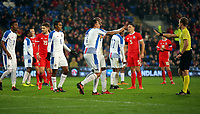 Blas Perez of Panama and team mate Felipe Baloy (C) protest to referee Bart Vertenten during the international friendly soccer match between Wales and Panama at Cardiff City Stadium, Cardiff, Wales, UK. Tuesday 14 November 2017.