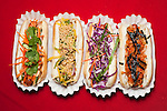 NEW YORK - FEBRUARY 27, 2010:  AsiaDog hotdogs--   Vinh, Sidney, Asian Slaw, and Ginny-- at their pop-up restaurant at a party in chinatown on February 27, 2010 in New York City.  (Photo by Michael Nagle)
