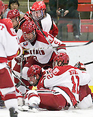 Jacob Drewiske (St. Lawrence - 13), Danny Biega (Harvard - 9), Chris Huxley (Harvard - 28), Colin Moore (Harvard - 12) - The Harvard University Crimson defeated the St. Lawrence University Saints 4-3 on senior night Saturday, February 26, 2011, at Bright Hockey Center in Cambridge, Massachusetts.