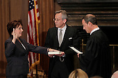 Elena Kagan is sworn in as the Supreme Court's newest member as Chief Justice John Roberts, right, administers the judicial oath, at the Supreme Court Building in Washington, Saturday, August 7, 2010. The Bible is held by Jeffrey Minear, center, counselor to the chief justice. Kagan, 50, who replaces retired Justice John Paul Stevens, becomes the fourth woman to sit on the high court, and is the first Supreme Court justice in nearly four decades with no previous experience as a judge. .Mandatory Credit: J. Scott Applewhite - Pool via CNP