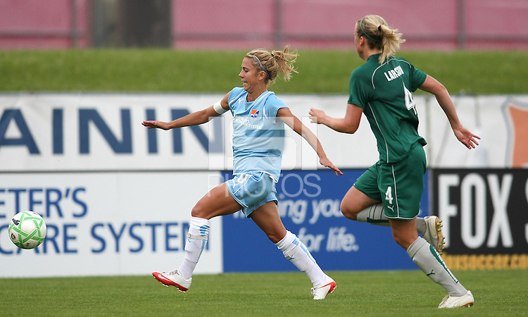 Kacey White of Sky Blue passes Sara Larsson of St Louis on the right flank.  St. Louis Athletica defeated Sky Blue FC 2-1 at Yurcak Field at Rutgers University in Piscataway, NJ on June 28, 2009.