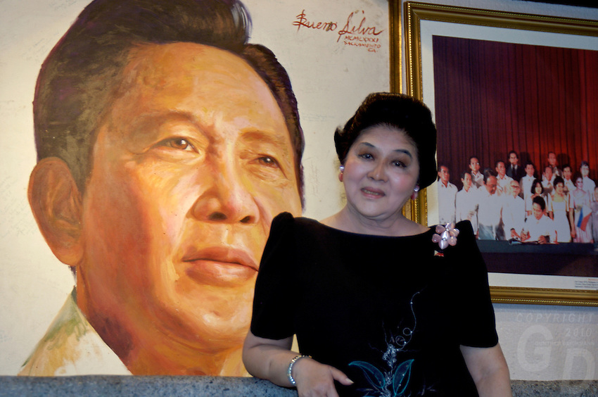 Former first Lady Imelda Marcos, in front of wall painting of her late husband president F.Marcos at her house in Manila, Philippines during 2006