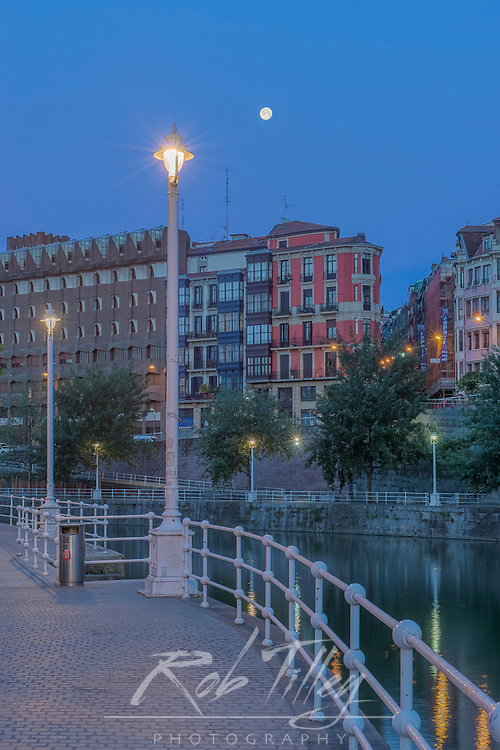Spain, Bilbao, Full Moon Over the Nervion River at Dawn