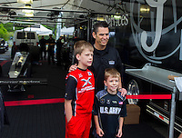 Jun 6, 2015; Englishtown, NJ, USA; A couple young fans pose with NHRA top fuel driver Larry Dixon for pictures during qualifying for the Summernationals at Old Bridge Township Raceway Park. Mandatory Credit: Mark J. Rebilas-