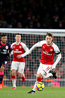 Mesut Ozil of Arsenal dribbles with the ball during the Premier League match between Arsenal and Huddersfield Town at the Emirates Stadium, London, England on 29 November 2017. Photo by Carlton Myrie / PRiME Media Images.