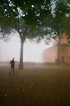 Figure in fog in Sienna, Italy