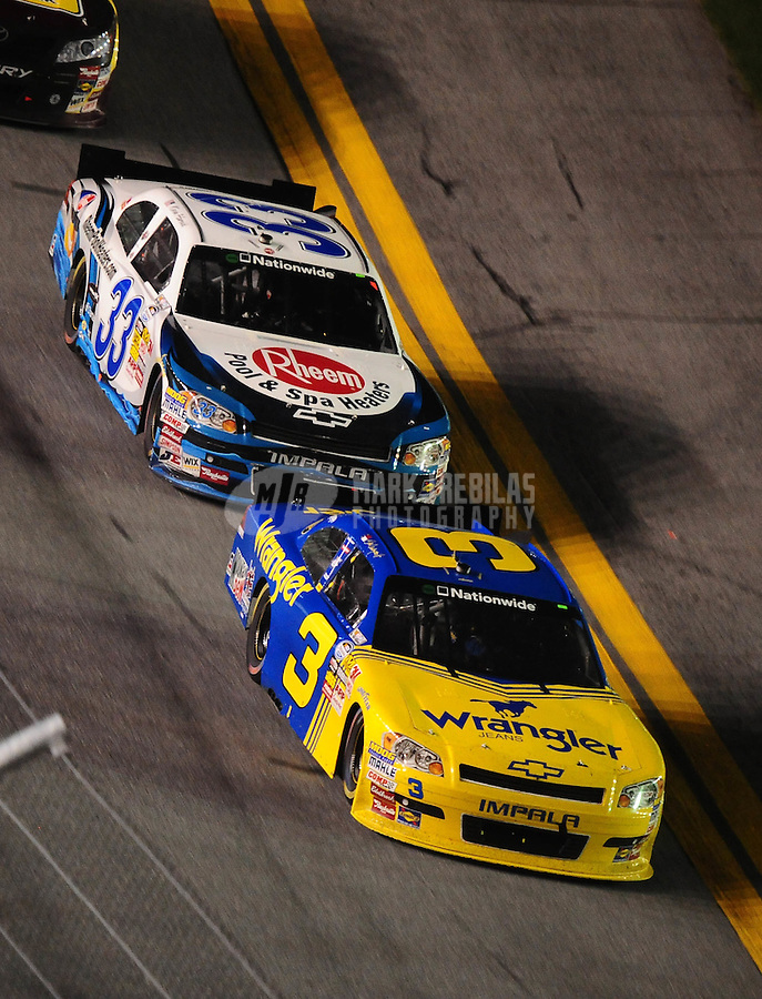 Jul. 2, 2010; Daytona Beach, FL, USA; NASCAR Nationwide Series driver Dale Earnhardt Jr (3) leads Kevin Harvick (33) during the Subway Jalapeno 250 at Daytona International Speedway. Mandatory Credit: Mark J. Rebilas-