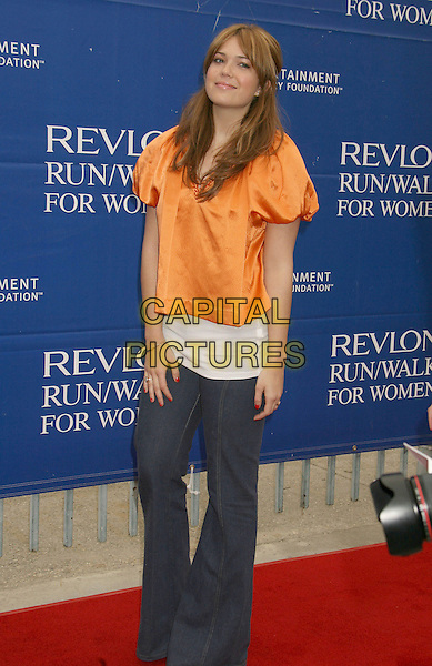 MANDY MOORE.14th Annual Entertainment Industry Foundation Revlon Run/Walk For Women held at The Los Angeles Memorial Coliseum, Los Angeles, California, USA,.12 May 2007..full 3/4  length orange satin top flared jeans.CAP/ADM/RE.©Russ Elliot/AdMedia/Capital Pictures.