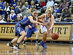 SIOUX FALLS MARCH 23:  Lauren Green #2 from Bentley University battles for the loose ball with Blair Taylor #14 from Lubbock Christian during their 2016 NCAA Women's DII Elite 8 Basketball Championship semifinal Wednesday night at the Sanford Pentagon in Sioux Falls, S.D. (Photo by Dave Eggen/Inertia)
