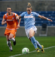 Chicago Red Stars forward Ella Masar (3) dribbles along the sideline as Sky Blue FC defender Megan Schnur (12) pursues.  The Chicago Red Stars tied Sky Blue FC 0-0 at Toyota Park in Bridgeview, IL on April 19, 2009.