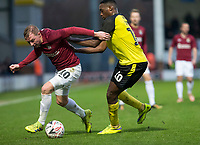 5th January 2020; Pirelli Stadium, Burton Upon Trent, Staffordshire, England; English FA Cup Football, Burton Albion versus Northampton Town; Nicholas Adams of Northampton Town is held back be Lucas Akins of Burton Albion  - Strictly Editorial Use Only. No use with unauthorized audio, video, data, fixture lists, club/league logos or 'live' services. Online in-match use limited to 120 images, no video emulation. No use in betting, games or single club/league/player publications