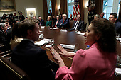 United States President Donald J. Trump listens as Ryan Nivakoff (L), NJOY Chief Executive Officer, and Meredith Berkman of Parents Against Vaping E-Cigarettes (PAVe), debate during a meeting on youth vaping and the electronic cigarette epidemic in the Cabinet Room at the White House in Washington on November 22, 2019. <br /> Credit: Yuri Gripas / Pool via CNP