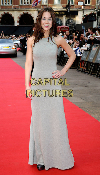 "ROXANNE McKEE .Arrivals at the UK Premiere of the new Batman movie ""The Dark Knight"", Odeon Leicester Square, London, England, .July 21st 2008. .full length grey gray dress maxi long hand on hip .CAP/CAN.©Can Nguyen/Capital Pictures"