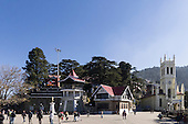 Shimla, Himachal Pradesh, India. Typical mixed architecturein the Upper Mall, or Ridge. Statue of Ghandi, the library and Christ Church.