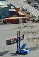 A fork-lift is moving a container in an empty container terminal where empty container lorries are around, at the Port of Tokyo in Japan. Industrial production in Japan plunged at the steepest pace in 55 years in the fourth quarter, and unemployment rose at the fastest rate in 41 years with exports in the third quarter were a record 13.9 per cent lower than in the previous quarter..19 Feb 2009