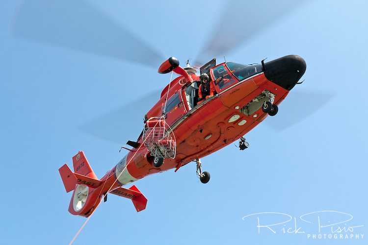 United States Coast Guard HH-65C Dolphin helicopter lowers a rescue basket. The helicopter and crew, based at U.S. Coast Guard Air Station San Francisco, was on a practice mission to maintain search and rescue proficiency.