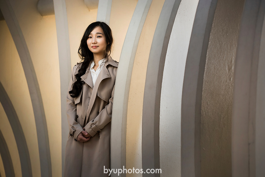 _E2_1021<br /> <br /> 1702-38 Euijin Oh<br /> <br /> Portrait of Korean student, Euijin Oh, by the Tree of Wisdom sculpture on BYU campus. <br /> <br /> December 9, 2016<br /> <br /> Photography by Nate Edwards/BYU<br /> <br /> © BYU PHOTO 2016<br /> All Rights Reserved<br /> photo@byu.edu  (801)422-7322
