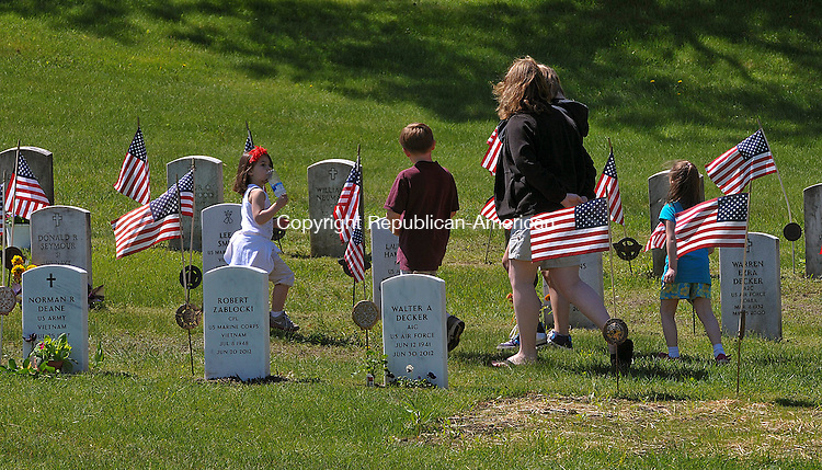 WINSTED, CT 27 MAY 2013--052713JS20- Julie Burrell of Barkhamsted takes her children and children of family friends, to pay their respect for veterans buried at Forest View Cemetery in Winsted on Monday. Burrell said it is important to teach the children what Memorial Day is all about. .Jim Shannon Republican American