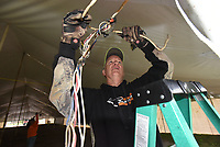 NWA Democrat-Gazette/FLIP PUTTHOFF<br />LIGHTS UP FOR FAIR<br />Fred Sutton with the War Eagle Fair board of directors installs wire and sockets for light bulbs  Wednesday Oct. 11 2017 in tents on the grounds of the War Eagle Fair. War Eagle and other arts and crafts fairs start next week. War Eagle Fair dates are Oct. 19-22. The fair was founded in 1954 on the banks of the War Eagle River.