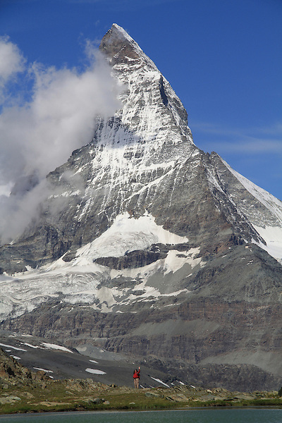 Visitor and the Matterhorn from the Gornergrat train, Zermatt, Switzerland. .  John offers private photo tours in Denver, Boulder and throughout Colorado, USA.  Year-round. .  John offers private photo tours in Denver, Boulder and throughout Colorado. Year-round.