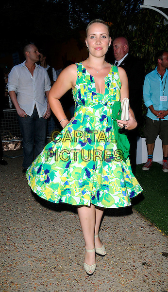 "CLAIRE RICHARDS .The ""Mamma Mia!"" world premiere afterparty, the FQEvents Marquee, Upper Ground, London, England..June 30th, 2008.after party full length green white yellow blue floral print dress hand on hip .CAP/CAN.©Can Nguyen/Capital Pictures."