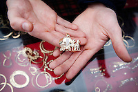 4/10/2010. A traveler holds a EUR240 9ct gold pendant of a horse and carrige  at the Ballinasloe Horse Fair, Ballinasloe, Ireland. Picture James Horan