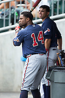 Eric Young Jr. (14) of the Gwinnett Braves waits for his turn to bat during the game against the Charlotte Knights at BB&T BallPark on July 3, 2015 in Charlotte, North Carolina.  The Braves defeated the Knights 11-4 in game one of a day-night double header.  (Brian Westerholt/Four Seam Images)