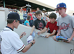 Aces coach Brett Butler signs autographs for young fans before the Monday night game.  Photo by Tom Smedes.