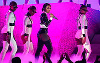 "Janelle Monae, center, performs ""Make Me Feel"" at the 61st annual Grammy Awards on Sunday, Feb. 10, 2019, in Los Angeles. (Photo by Matt Sayles/Invision/AP)"