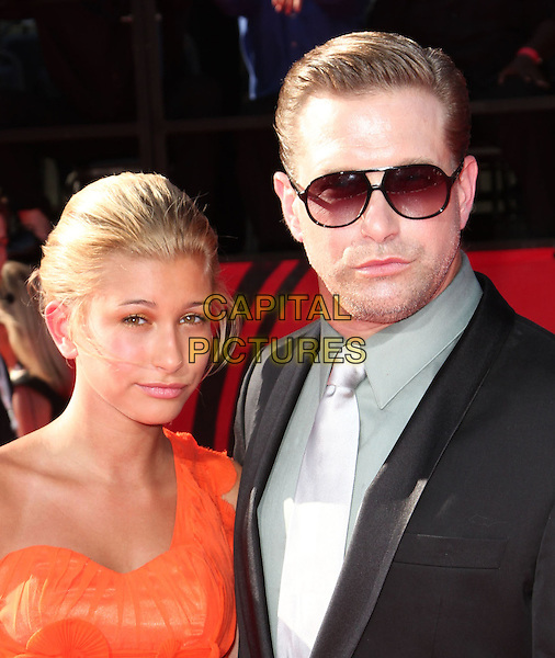 HAILEY BALDWIN & STEPHEN BALDWIN .18th Annual ESPY Awards - Arrivals held at The Nokia LA Live, Los Angeles, CA, USA, 14th July 2010..espys portrait headshot orange father dad daughter family one shoulder sunglasses suit tie aviators silver grey gray .CAP/ADM/KB.©Kevan Brooks/AdMedia/Capital Pictures.