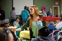 NWA Democrat-Gazette/JASON IVESTER <br /> Stephanie Barra of Fayetteville helps serve meals on Tuesday, Nov. 24, 2015, during the annual Thanksgiving dinner at the Samaritan Community Center in Rogers. The center also handed out Blessing Bags filled with Thanksgiving meals and turkeys to visitors. Over 1000 were expected to be served dinner at the Springdale and Rogers centers during the day.