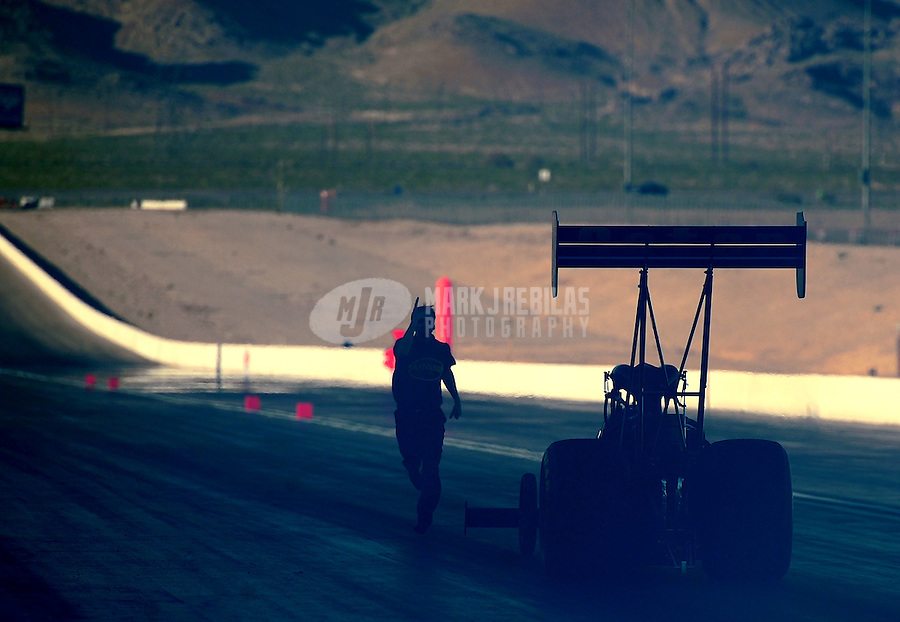 Apr. 1, 2011; Las Vegas, NV, USA: NHRA top fuel dragster driver Del Worsham is guided back by a crew member after doing his burnout during qualifying for the Summitracing.com Nationals at The Strip in Las Vegas. Mandatory Credit: Mark J. Rebilas-
