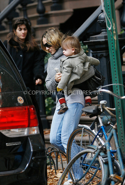 WWW.ACEPIXS.COM . . . . .....October 31 2010, New York City....Actress Sarah Jessica Parker carries one of her twin girls to a waiting car, whilst a nanny brings the second one from her house in the West Village on October 31 2010 in New york City....Please byline: NANCY RIVERA- ACEPIXS.COM.... *** ***..Ace Pictures, Inc:  ..Tel: 646 769 0430..e-mail: info@acepixs.com..web: http://www.acepixs.com