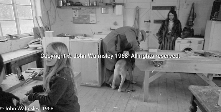 A.S.Neill collecting his dog, carpentry workshop, Summerhill school, Leiston, Suffolk, UK. 1968.  The young lady in the background is Hassie Vogel, a fellow student of John Walmsley's at Guildford School of Art.