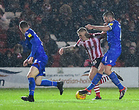 Lincoln City's Harry Anderson gets between Morecambe's Luke Conlan, left and Alex Kenyon<br /> <br /> Photographer Andrew Vaughan/CameraSport<br /> <br /> The EFL Sky Bet League Two - Saturday 15th December 2018 - Lincoln City v Morecambe - Sincil Bank - Lincoln<br /> <br /> World Copyright © 2018 CameraSport. All rights reserved. 43 Linden Ave. Countesthorpe. Leicester. England. LE8 5PG - Tel: +44 (0) 116 277 4147 - admin@camerasport.com - www.camerasport.com