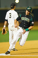Shane Basen #8 of the Charlotte 49ers rounds third base against the Wake Forest Demon Deacons at Gene Hooks Field on March 22, 2011 in Winston-Salem, North Carolina.   Photo by Brian Westerholt / Four Seam Images