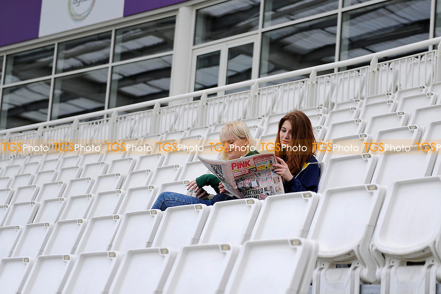 Spectators read the news while waiting for play -Hampshire CCC vs Worcestershire CCC - LV County  Championship Cricket Match at the Ageas Bowl, Hampshire - 06/04/14 - MANDATORY CREDIT: Denis Murphy/TGSPHOTO - Self billing applies where appropriate - 0845 094 6026 - contact@tgsphoto.co.uk - NO UNPAID USE