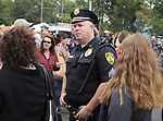 One of the Saugerties Police Officers on duty around, the Kiwanis Club of Saugerties sponsored, Hudson Valley Garlic Festival, at Cantine Field, in Saugerties, NY, on Saturday, September 30, 2017. Photo by Jim Peppler. Copyright/Jim Peppler-2017.
