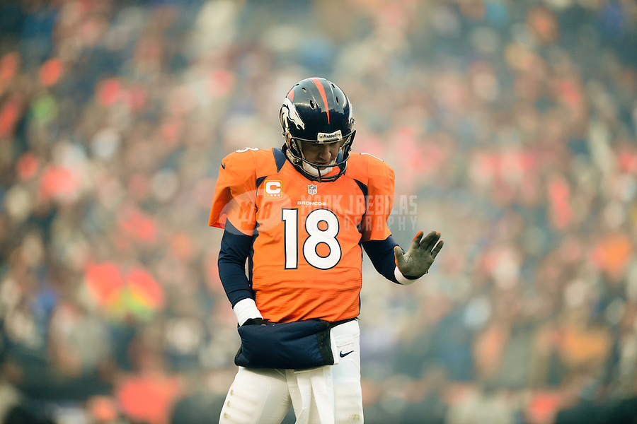 Jan 12, 2013; Denver, CO, USA; Denver Broncos quarterback Peyton Manning (18) reacts in the first half against the Baltimore Ravens during the AFC divisional round playoff game at Sports Authority Field.  Mandatory Credit: Mark J. Rebilas-