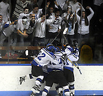 Teammates mob Eagles 2, Brian O'Connell, in the first period, as classmates in the stands join in, during the CIAC High School Division Two State Championship between East Catholic and Fairfield Warde / Ludlowe,  Wednesday, March 20, 2013, at Ingalls Arena at Yale University in New Haven,  the Eagles lost the game in overtime 4-3.  (Jim Michaud / Journal Inquirer).
