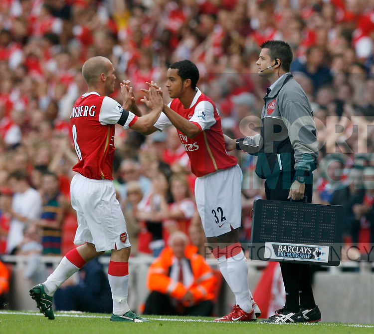 Arsenal's Theo Walcott makes his premier league debut coming on as substitute for Fredrik Ljungberg