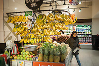 Banana display in the produce department in the new Whole Foods Market opposite Bryant Park in New York on opening day Saturday, January 28, 2017. The store in Midtown Manhattan is the chain's 11th store to open in the city. The store has a large selection of prepared foods from a diverse group of vendors inside the store.  (© Richard B. Levine)