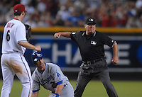 Jun 27, 2007; Phoenix, AZ, USA; Second base umpire Derryl Cousins signals out after Arizona Diamondbacks shortstop (6) Stephen Drew tagged out Los Angeles Dodgers outfielder (26) Luis Gonzalez at Chase Field. Mandatory Credit: Mark J. Rebilas