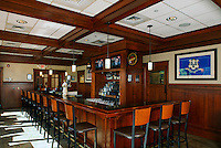Arts & Crafts style wood panelled bar with coffered ceiling.