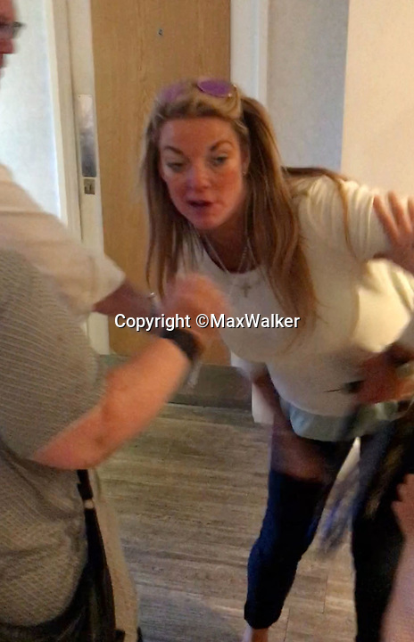 BNPS.co.uk (01202 558833)<br /> Pic: MaxWalker/BNPS<br /> <br /> Attempts are made to restrain Vowles before she rushes into the ladies toilets at the upmarket marina.<br /> <br /> Grabs from Max Walker's video of Rebecca Vowles attack on Samantha Newby-Vincent.<br /> <br /> The ex-fiancee of a millionaire businessman denied started a cat fight with his new girlfriend - because she 'loved her nails too much'.<br /> <br /> Rebecca Vowles, 47, said she couldn't have banged down a locked toilet cubicle door to attack terrified love rival Samantha Newby-Vincent as it might have damaged her immaculate nails.<br /> <br /> But magistrates found the glamorous blonde defendant guilty of assault after being shown a video recording of the attack that happened in the ladies' loos at an exclusive marina in Poole, Dorset.