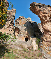 Phrygian tombs cut into rock formations  protecting the citadel of Midas . From the 8th century BC . Midas City, Yazilikaya, Eskisehir, Turkey.<br /> <br /> <br /> The earliest Phrygian settlement here began in the last quarter of the 8th century BC. Even after the Phrygian kingdom collapsed politically, the city was not abandoned and the Phrygian rock structures and tombs were conserved, with some additions and changes made.in the Persian, Hellenistic, Roman and Byzantine periods.