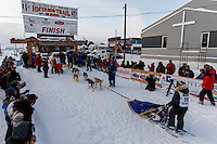 Marcelle Fressineau runs into the finish chute to claim 49th and last place at Nome as Lisbet Norris arrived just a minute before her on Saturday March 15 during the 2014 Iditarod Sled Dog Race.<br /> <br /> PHOTO (c) BY JEFF SCHULTZ/IditarodPhotos.com -- REPRODUCTION PROHIBITED WITHOUT PERMISSION